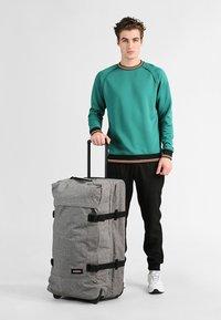 Eastpak - TRANVERZ L - Wheeled suitcase - sunday grey - 1