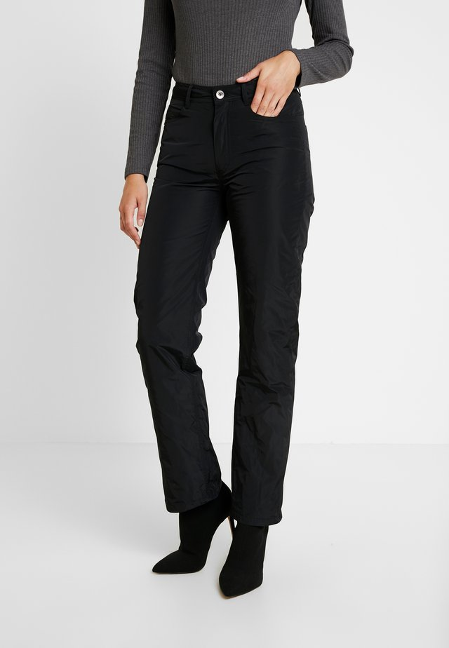 FRANKY - Trousers - black