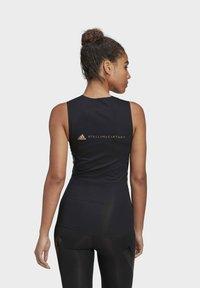 adidas by Stella McCartney - SUPPORT CORE  - Sports shirt - black - 2