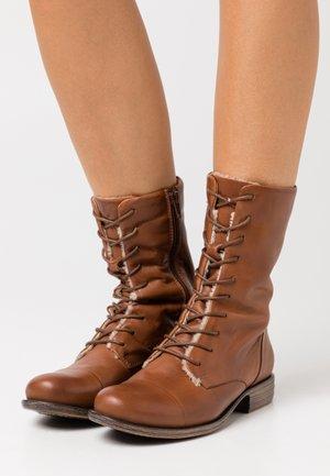 LEATHER - Lace-up boots - cognac