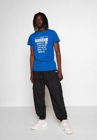 Diesel - T-DIEGO-S1 T-SHIRT - T-shirt con stampa - blue - 1