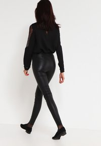 Selected Femme - SFSYLVIA - Leather trousers - black - 2