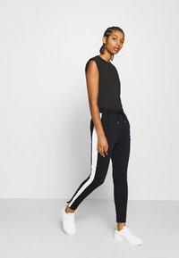 Puma - CLASSICS TRACK PANT  - Pantaloni sportivi - black - 1