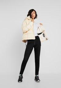 adidas Performance - Z.N.E. DOWN JACKET - Winter jacket - sand - 1