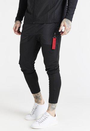 ADAPT FLIGHT PANTS - Verryttelyhousut - black