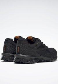 Reebok - RIDGERIDER GTX 5.0 SHOES - Hiking shoes - black - 6