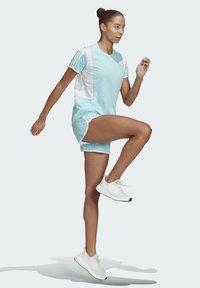 adidas Performance - STRIPES ITERATION T-SHIRT - T-shirts med print - blue - 1