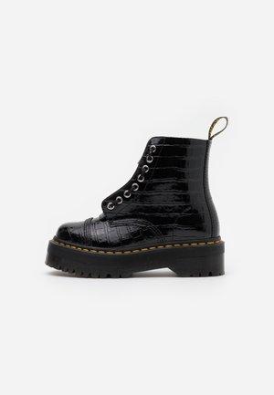 SINCLAIR - Platform ankle boots - black