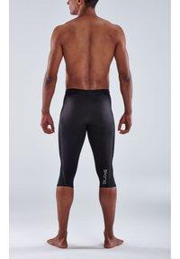 Skins - 3/4 sports trousers - black - 2