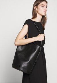 PB 0110 - Handbag - black - 0