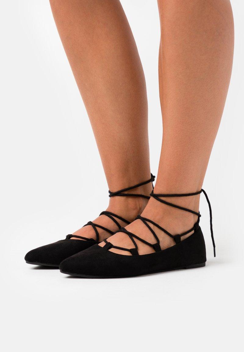 BEBO - ANYTA - Ankle strap ballet pumps - black