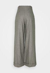 sandro - COUREY - Trousers - noir / blanc - 1