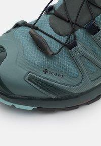 Salomon - XA PRO 3D V8 GTX - Trail running shoes - balsam green/green gables/pastel turquoise - 5