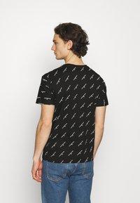 Calvin Klein Jeans - LOGO UNISEX - Print T-shirt - black - 2