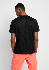 adidas Originals - MONOGRAM RETRO JERSEY - T-shirt med print - black - 2