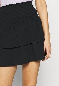 Pieces - PCTILY SMOCK SKIRT - Mini skirt - black - 4