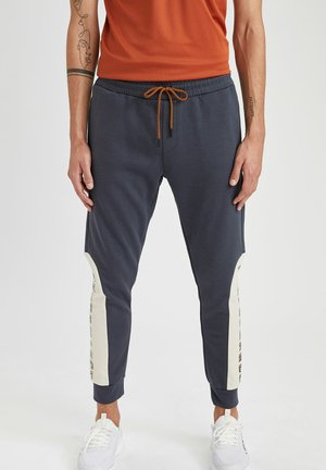 SLIM FIT  - Pantaloni sportivi - indigo