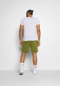 Jack & Jones Performance - JJIZPOLYESTER SHORT - Sports shorts - winter moss - 2