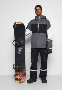 Burton - BANSHY CASTLEROCK  - Snowboard jacket - castlerock/multi - 1