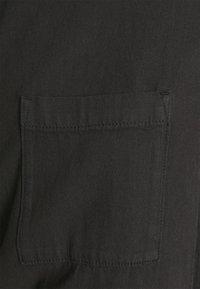 Monki - MONA DUNGAREES - Jumpsuit - black dark - 4