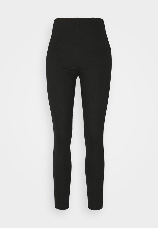 PUNTI - Leggings - Trousers - black