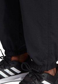 adidas Performance - ESSENTIALS PLAIN STANFORD TROUSERS - Spodnie treningowe - black - 4