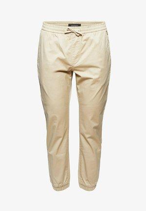 FASHION - Tracksuit bottoms - beige