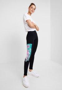 Desigual - PORTRAIT - Leggings - Trousers - black - 1