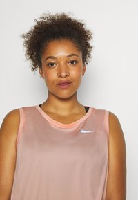 Nike Performance - MILER TANK PLUS - Sports shirt - washed coral/reflective silver - 3