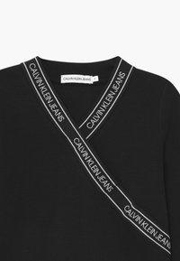 Calvin Klein Jeans - WRAP - Long sleeved top - black - 2