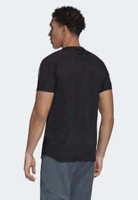 adidas Performance - ZUPAHIKE AEROREADY SHIRT - T-shirts med print - black - 2