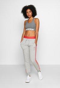 adidas Performance - PANT - Tracksuit bottoms - grey/pink - 1