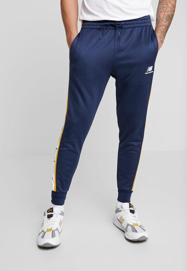 NB ATHLETICS TRACK PANT - Pantalon de survêtement - natindgo