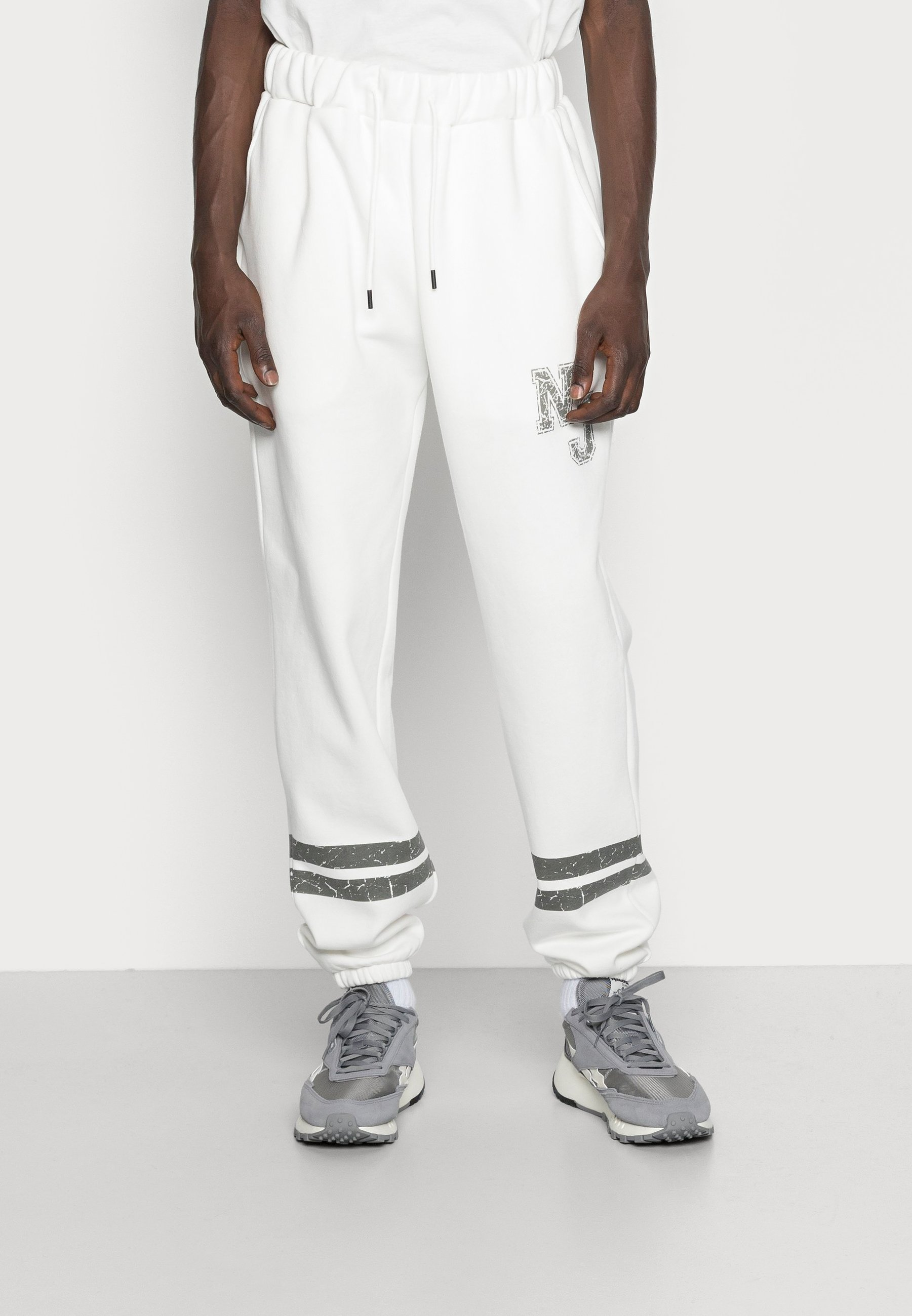Hombre HERITAGE COLLEGE TRACKPANT - Pantalones deportivos