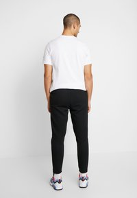 Nike Sportswear - Træningsbukser - black/anthracite - 2