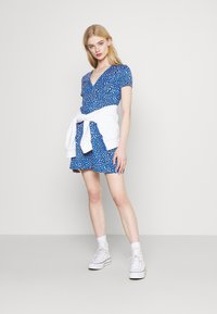 Tommy Jeans - FLARE LEO PRINT DRESS - Jersey dress - blue - 1
