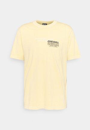 T-JUBINDY - T-shirts med print - yellow