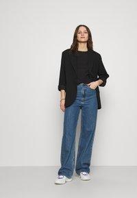 Calvin Klein - SMALL NECK  - Jednoduché triko - black - 1