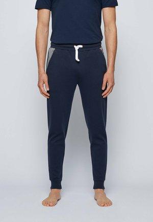 COMTEMP - Tracksuit bottoms - dark blue