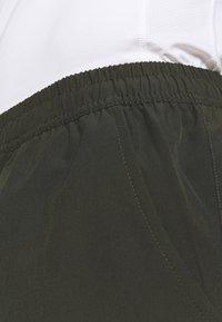 Endurance - GATUN SHORTS - Sports shorts - rosin - 5