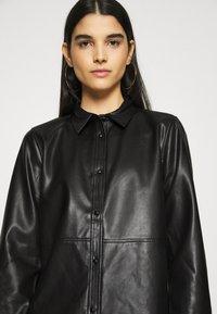 Vila - VINALIA COATED - Button-down blouse - black - 3