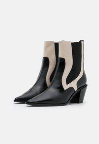 Casadei - Cowboy/biker ankle boot - sense nero/offwhite - 2