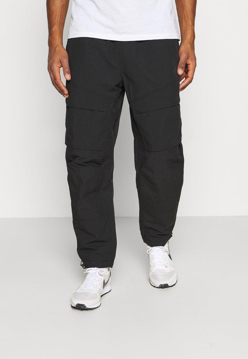 Nike Sportswear - Trousers - black