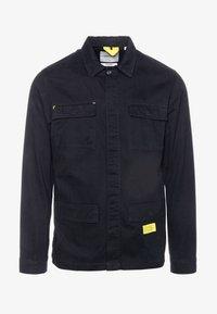 JCOHOGGLE - Lehká bunda - black