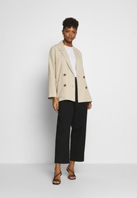Weekday - MINO TROUSERS - Trousers - black - 1