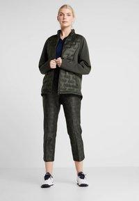 adidas Golf - PRINTED PULLON ANKLE PANT - Bukser - black - 1