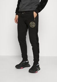 Glorious Gangsta - HERVOS JOGGERS - Tracksuit bottoms - black - 0