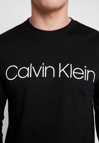Calvin Klein - LOGO LONG SLEEVE  - T-shirt à manches longues - black