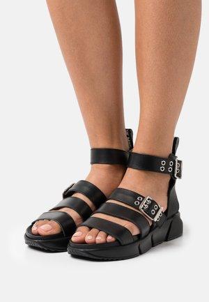 MILTA - Platform sandals - black