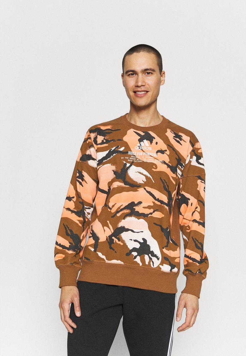 adidas Performance - ZNE CREW - Sweatshirt - brown
